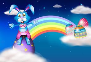 Un lapin de Pâques et des œufs près de l'arc-en-ciel