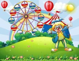 Un clown au sommet d'une colline avec un carnaval et un arc-en-ciel à l'arrière