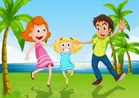 Une famille heureuse danse près de la rivière
