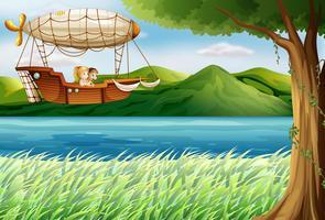 Un dirigeable près de la rivière transportant deux filles