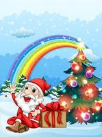 Père Noël assis à côté du cadeau près de l'arc-en-ciel