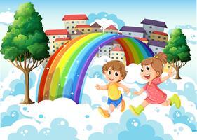 Enfants jouant près de l'arc-en-ciel