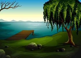 Un lac à la forêt vecteur