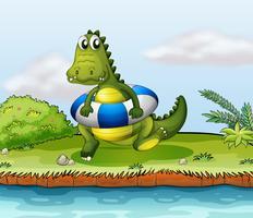 Un crocodile au bord de la rivière avec une bouée vecteur