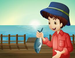 Un pêcheur tenant un poisson au port vecteur