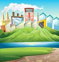 Montagnes vertes près de la rivière et des bâtiments