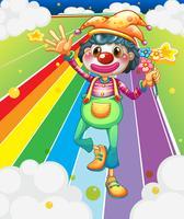 Un clown féminin avec des fleurs sur la route colorée