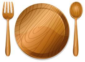 Assiette en bois avec une paire de fourchette et une cuillère vecteur