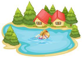 Une fille nageant près des pins