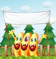 Trois monstres sous la bannière vide vecteur