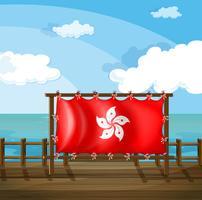 Un cadre en bois sur le pont avec le drapeau de Hong Kong vecteur