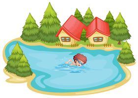 Une plage près des pins avec un garçon qui nage