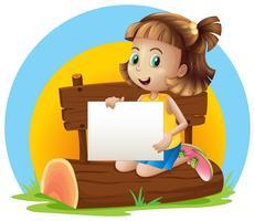 Une fille au-dessus d'un journal tenant un affichage vide