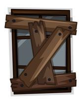 Fenêtre cassée avec des planches en bois dessus