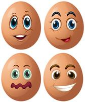 Œufs avec quatre expressions faciales différentes vecteur