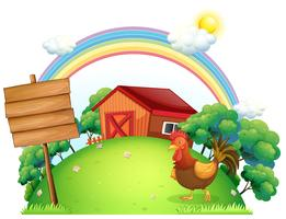 Un coq et les planches vides devant une maison