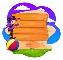 Planche de bois avec clown sur ballon