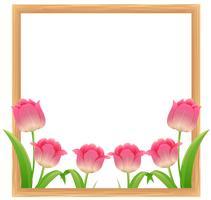 Modèle de cadre avec des fleurs de tulipes roses