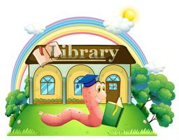 Un ver portant une casquette de graduation en train de lire devant la bibliothèque