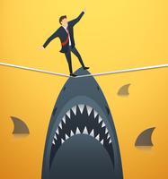 illustration d'un homme d'affaires marchant sur une corde avec des requins sous un risque commercial