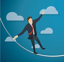 concept d'homme d'affaires ou d'homme en crise, marchant en équilibre sur une corde sur fond de ciel