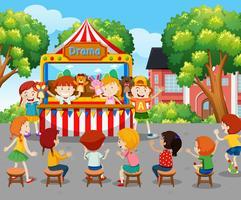 Enfants regardant un spectacle de marionnettes à l'extérieur vecteur