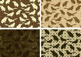 Paquet de motifs vectoriels d'oiseaux avec de minuscules coeurs vecteur