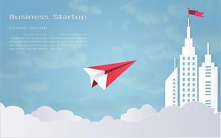 Concept de leadership, avion rouge et paysage architectural blanc avec un drapeau sur le dessus, fond de ciel bleu.