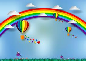 Papier découpé en forme de cœur avec arc-en-ciel et ballons pour fierté LGBT ou GLBT, ou lesbienne, gay, bisexuelle, transgenre, sur fond bleu
