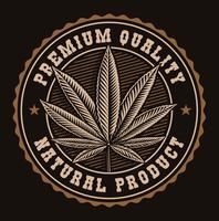 Badge vintage d'une feuille de cannabis.