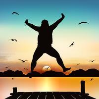 Silhouette et fille sautante au crépuscule avec un ciel bleu.
