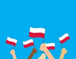 Mains d'illustration vectorielle tenant des drapeaux de la Pologne sur fond bleu vecteur