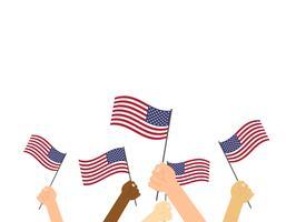 Mains humaines tenant des drapeaux des États-Unis sur fond blanc vecteur