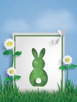 Carte de voeux en forme de lapin sur jardin avec papillon