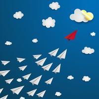 Avion en papier rouge menant les blancs, concept de leadership.