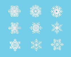 Ensemble de flocons de neige en papier coupé style sur fond bleu. Illustration vectorielle