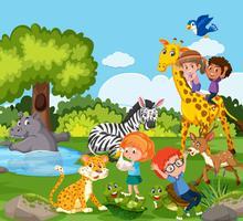 Enfants jouant avec un animal sauvage vecteur