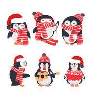 pingouin d'hiver portant un ensemble bonnet et écharpe rouge