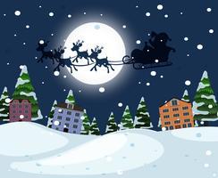 Silhouette Père Noël en traîneau sur la ville