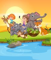 Filles jouant avec des animaux sauvages
