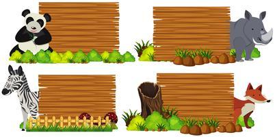 Quatre planches de bois avec des animaux vecteur