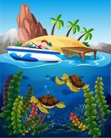 Gens en bateau et tortues sous la mer