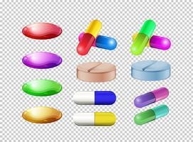 Différentes couleurs de pilules sur fond transparent