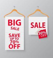 Promotion de vente avec cintre et bannière vecteur