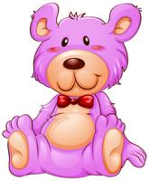 Un ours en peluche rose sur fond blanc