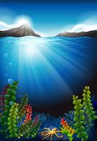Scène sous l'eau et les montagnes vecteur