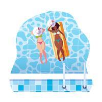 belles filles interraciales avec matelas de flotteur dans l'eau