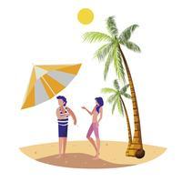 jeune garçon avec femme sur la scène d'été de la plage
