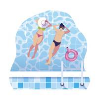 jeune couple avec maillot de bain flottant dans la piscine