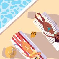femmes en maillot de bain bronzant dans la piscine